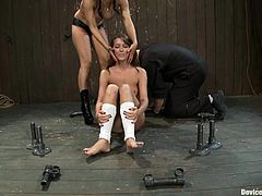 Adorable Alicia Stone gets tied up by Isis Love. Then she get her pussy fingered and ass toyed with a strap-on. She also gets her feet whipped with a stick.
