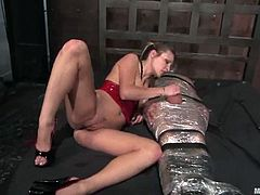 Sexy blonde mistress ties the guy up with straps. After that she fixes clothespins to his chest and gives hot blowjob.