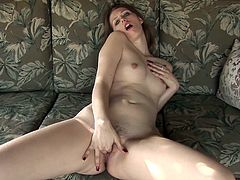A gorgeous babe with small tits and pale skin strokes her pussy and rubs her clit till she gets an orgasm, check it out!