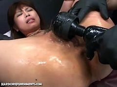 Check this provocative and intense Japanese sex slave as she gets tied up by a horny master and a sexy mistress. They can't wait to oil and dildo her hairy clam into spectacular orgasms.