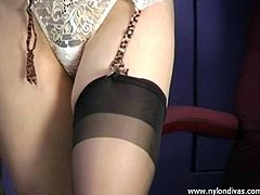 Blonde Ginger having fun in her lingerie and putting on her black sheer fully fashioned nylon stockings
