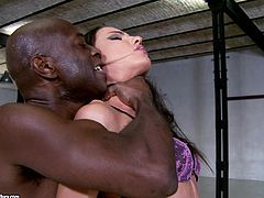 Delightful brunette chick in sexy lingerie stands on all fours on a sofa. She sucks big black cock and gets rammed from behind by a White dude.