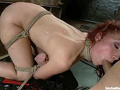 This gorgeous redhead bitch Nicki Hunter is going to be suppressed in this BDSM porn. She gets tied up and her master fucks her twat and her face with his huge penis!