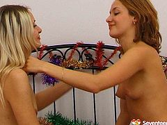 Two tasty looking Russian Snow Maidens decide to play dirty lesbian games. They stroke each other's steamy bodies before they toy their cunts with two-headed dildo.