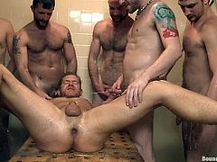 One guy is being objected to an insane fetish gay gangbang. He is tied up and these fellas are now gonna let him go till they cum in his ass!