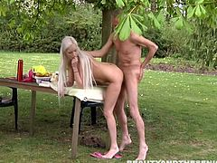Gosh, this awesome blond babe is the owner of mesmerizing big boobs and nice rounded ass. Slender long legged cutie never misses a chance to be pounded hard outdoors. Ardent nympho sucks the old man's dick and begs to fuck her wet pussy mish right on the garden table.