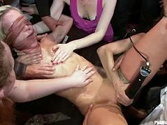 Skinny blonde is having fun with a few guys indoors. The people tie the blondie up and make her moan with pain.