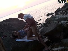 Don't miss this hot scene where a couple gets down and dirty outdoors, by the sea in the rocks. Girl bends over and gets her pussy nailed from behind.