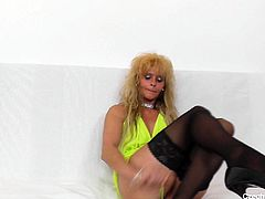 Nasty mature blonde is eager for sex fun. She takes her favorite dildo toy and fucks her insatiable pussy with her stockings legs wide open.