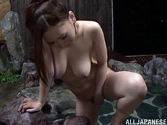 Gorgeous Japanese chick is playing dirty games and allows two dudes watch her. She kneads her fantastic natural boobs and also pleases herself with passionate fingering.