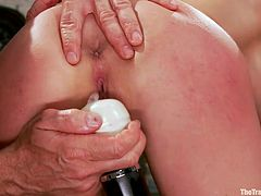 Riley Evans gets her tits fucked and her pussy played with by two dominating men. She is made too deep throat cock against her will while and whipped mercilessly. She gets a hitachi vibrator pressed hard against her pussy while cock is shoved in her chest and the she gags with dick