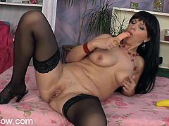 A hot solo scene with a mature whore as she fucking sticks a hard toy in her pink motherfucking cunt, check it out right here!