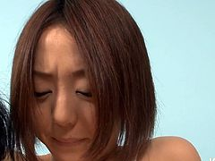 Juggy Japanese amateur is having her first time gangbang sex experience. She opens her legs wide open lying on her back blindfolded in front of aroused wankers to tickle her bushy cunt with vibrator.