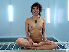 A dirty electro slut gets put in a small metal cage as they stick pads to her and run current through her body, check it out!