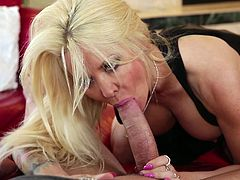 blonde milf with juicy lips gives head.