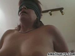 This mature amateur is blindfolded when she gets double toyed. Then, she sucks the cock out of her ass and gets a messy facial.