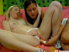 Seventeen Video sex clip presents two kinky teen lesbos. Already naked brunette and blondie wear only socks. They've got a dildo for a proper polishing of their wet pussies on the couch. Pale blondie and tanned brunette with small natural tits desire to gain maximum delight tonight.