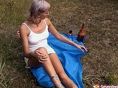 Well, I bet you've never seen such a voracious and werid amateur wanker like this whorish blondie in Seventeen Video sex clip. Spoiled blondie stops the car on the country road. She undresses on the lawn and while being tipsy pale gal with nice boobs uses a bottle neck to please her wet cunt outdoors.