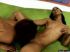 Lustful black girl with small tits knows how to make her girlfriend happy. She fingers her pussy fervently and then she spreads her legs wide to let her girlfriend eat her snatch.