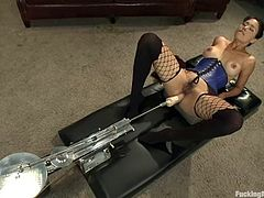 Busty brunette Dana Vespoli wearing fishnet stockings is getting naughty indoors. She rubs her hot snatch and then gets her ass pounded by a fucking machine.