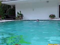 Serena Torres is a bikini-clad teenage sexy. Petite dark haired girl flashes her small tits and then spreads her legs wide and flash her pussy, She has a nice time playing in the pool and showing her naughty bits to Jmac.