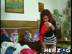 This German babe is doing the laundry when she gets turned on by her panties. She changes into pink panties and starts masturbating right then and there. She is caught and embarrassed. The man she's caught by joins in and jacks off on her chest. The other housemates hear this and they fuck hard too.