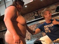 This busty fat chick strips in front of four people. She gives a blowjob to one of the guys as well.