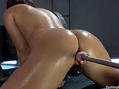 Superb Italian babe toys her pussy with a vibrator but that is not enough for her. So, she turns her fucking machine on and gets toyed by it.