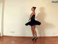Ballerina beauty dances and strips for us