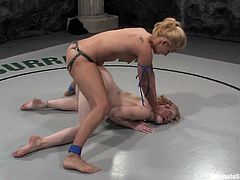 A couple of hot blonde bitches get on a ring and they start fighting each other while naked the loser gets fucked by the winner who wears a strapon.
