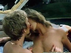 These two hotties from the sixties begin to kiss each other while they are outdoors, in the pool. They continue with pussy licking.