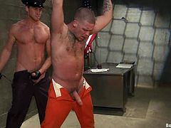 Caleb Colton is having BDSM fun with Connor Maguire in a jail. Caleb gets bound and tormented and then enjoys Connor's dick in his tight butt.