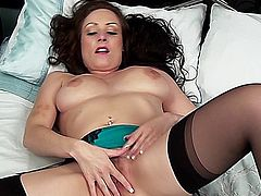 Hot milf babe fingering her tight pussy