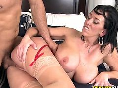 Nasty brunette chick with big boobs takes her red lingerie off and gives passionate blowjob. After that she gets fucked her shaved pussy fucked.