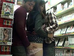 Japanese people always find a place to fuck. This time the sex story takes place in the magazine store. Babe gets nailed by two dudes in the porn magazine section!