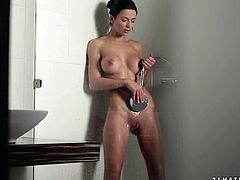 Amazingly beautiful girl with silicon tits is taking shower in a bathroom