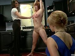 Redhead Lea gets humiliated by blonde Bobbi. She gets tortured with clothespins. After that she gets whipped and fucked with a strap on in her ass.