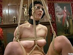 Horny brunette chick gets hanged up above the floor. After that she gets her pussy fingered and fucked hard by her master.