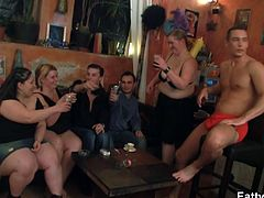 Watch some horny and vicious fatties partying with some nasty studs in this hot video. One of them is ready to blow a hard cock right in front of everybody else.