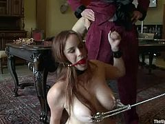Bella Rossi and Sarah Shevon are two sex slaves. They do whatever their master wants. So, they fuck each others with strap-on.