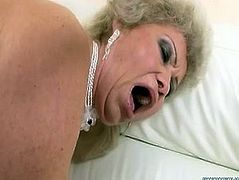 Trashy granny wearing white nylon stockings and red corset bends over the couch lifting her ass up in the air. Perverted dude butt plugs her with sex machine. He also pins her vaginal folds causing her pain and joy at a time. Nasty granny cums getting brutally fucked in her butt hole.