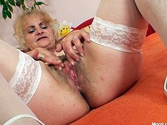 Are you looking for kinky mom who prefers solo masturbating. She looks hot in white stockings and white lingerie. Enjoy her hairy pussy right now.