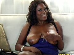 Slutty ebony chick fondles her pussy and big natural tits. After that she gets fucked hard by some White dude. This dude also cums in Dolce's mouth.