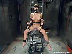 Cute blonde chick Jenni Lee lets some guy bind and suspend her in a cellar. Then the man drowns Jenni and enjoys the way she moans.