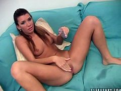 Betty Saint is sitting on a couch naked with her legs wide open. Betty is getting her coochie fisted during dirty porn photo shoot.