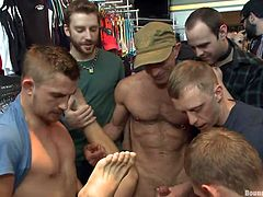 Check out what trouble this cutie got himself in. There's a crowd that's sitting in line to fuck his ass and mouth and damn these guys are anxious to fuck him. He's tied tightly with rope and the guys rub their cocks in front of him while one deeply fucks his anus. He won't leave until everybody is satisfied.