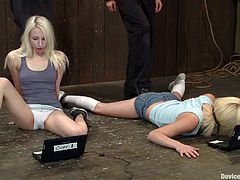 Two stunning girls lie on the floor being bonded. These blondies get their hot pussies toyed with vibrators and dildos. They also get fingered deep.