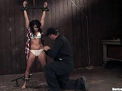 Hot bondage scene with brunette slut