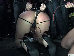This juicy blondie gets a ball gag in her mouth and so the perversions of BDSM lovers star. The crowd circle them around quickly and watch this public action!