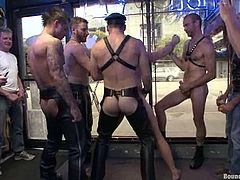 They had gathered a huge crowd around and now it is a showtime! They tie their slave up and start giving him a lot of pain!